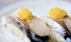 Yuzu citrus tobiko on sushi